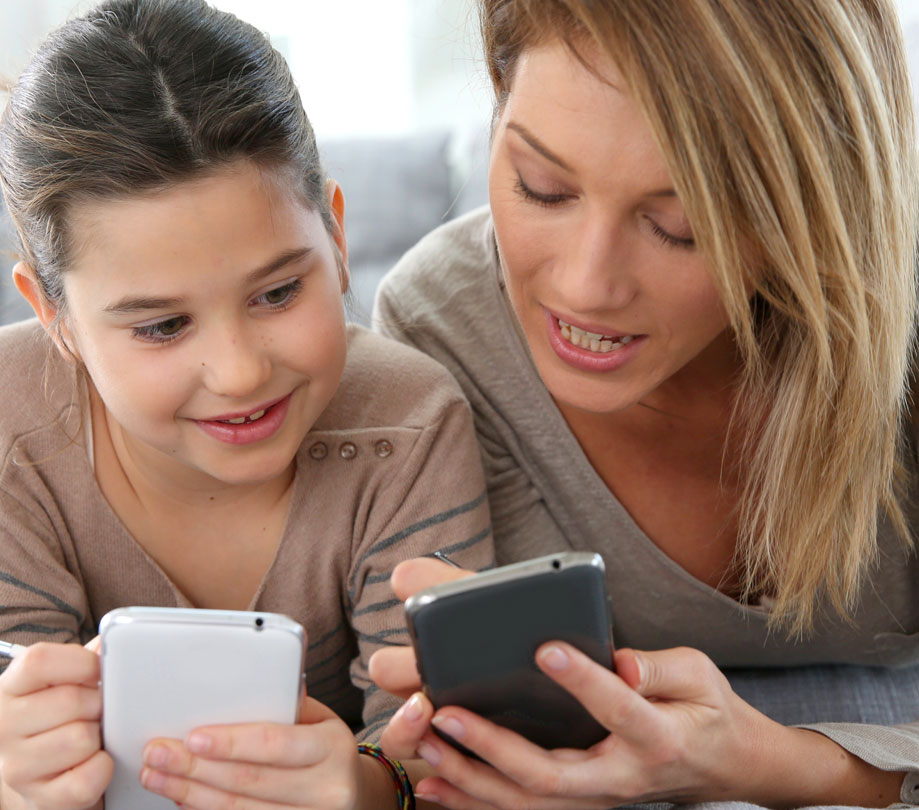 Mother and Daughter Playing Mobile Games on SmartPhone App Developer Magazine