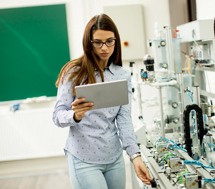 Woman Using IoT Sensors In Lab
